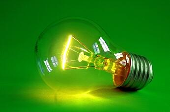 lightbulb on green symbolizing rebounding with good ideas
