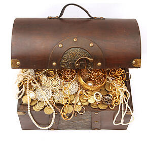 Gold treasure chest representing the value of previously funding grant applications for grant writers