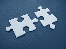 Puzzle pieces representing finding a grant funder that fits organizational needs