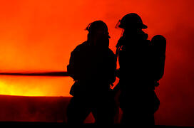 Firefighter silhouettes representing FEMA fire safety and prevention grants