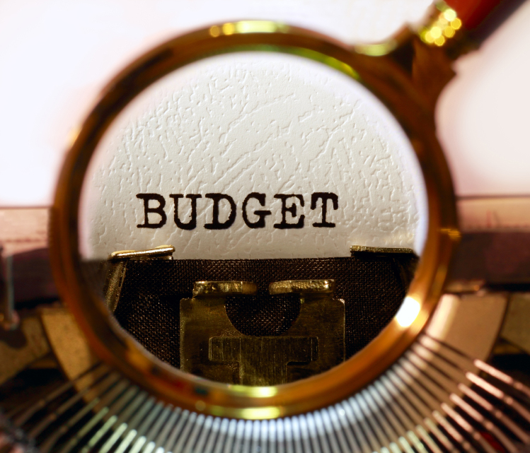 """""""Budget"""" typed by typewriter for article on local governments budgeting and grants in FY2015"""