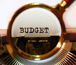 """Budget"" typed by typewriter for article on local governments budgeting and grants in FY2015"