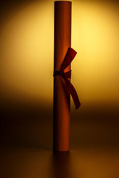 Scroll of paper with a ribbon representing a federal grant award notice