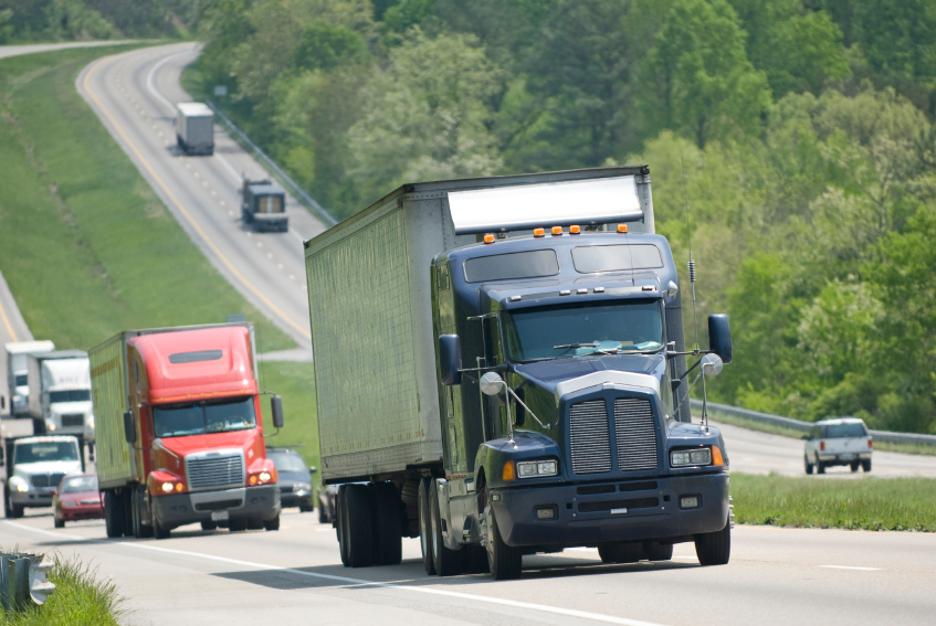 Trucks headed up rural highway, Highway Transportation Fund insolvency risk