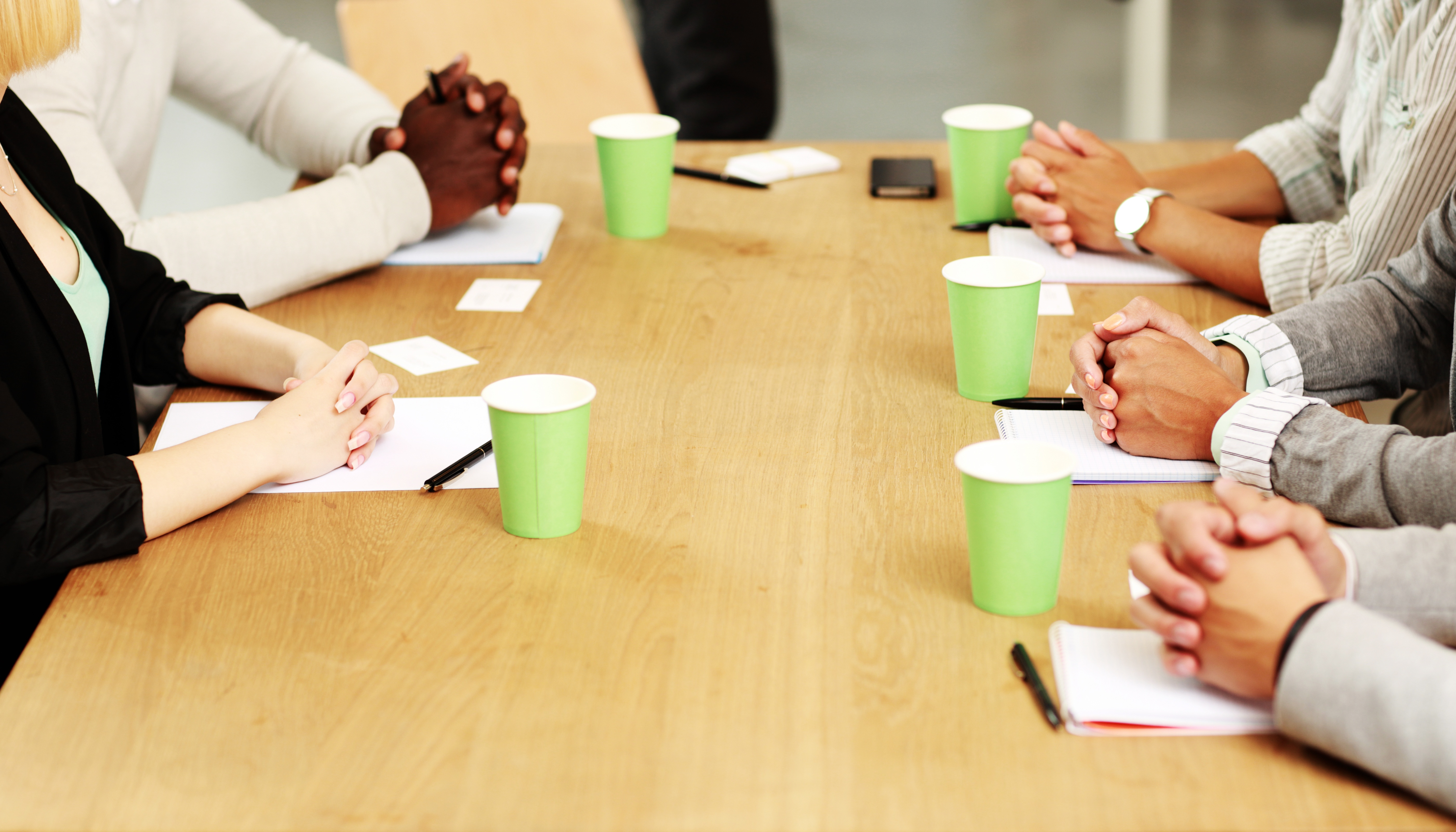 People-Around-Table-In-Article-About-America's-Promise-Job-Driven-Grant-Program