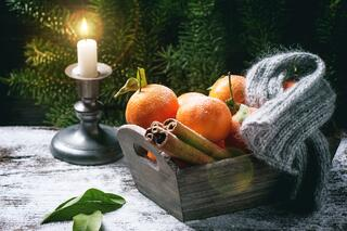 Fruit and Candle in an Article About Literacy Grants