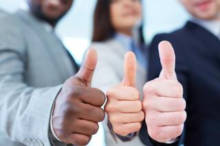 Multicultural Thumbs Up Picture in an Article About Becoming a Grant Peer Reviewer