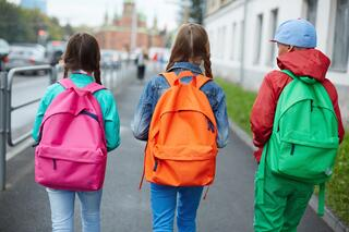 Children With Colorful Backpacks in an Article About AmeriCorps State and National Grants