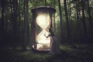 Hourglass in Woods in an Article About  Missing Grant Deadlines