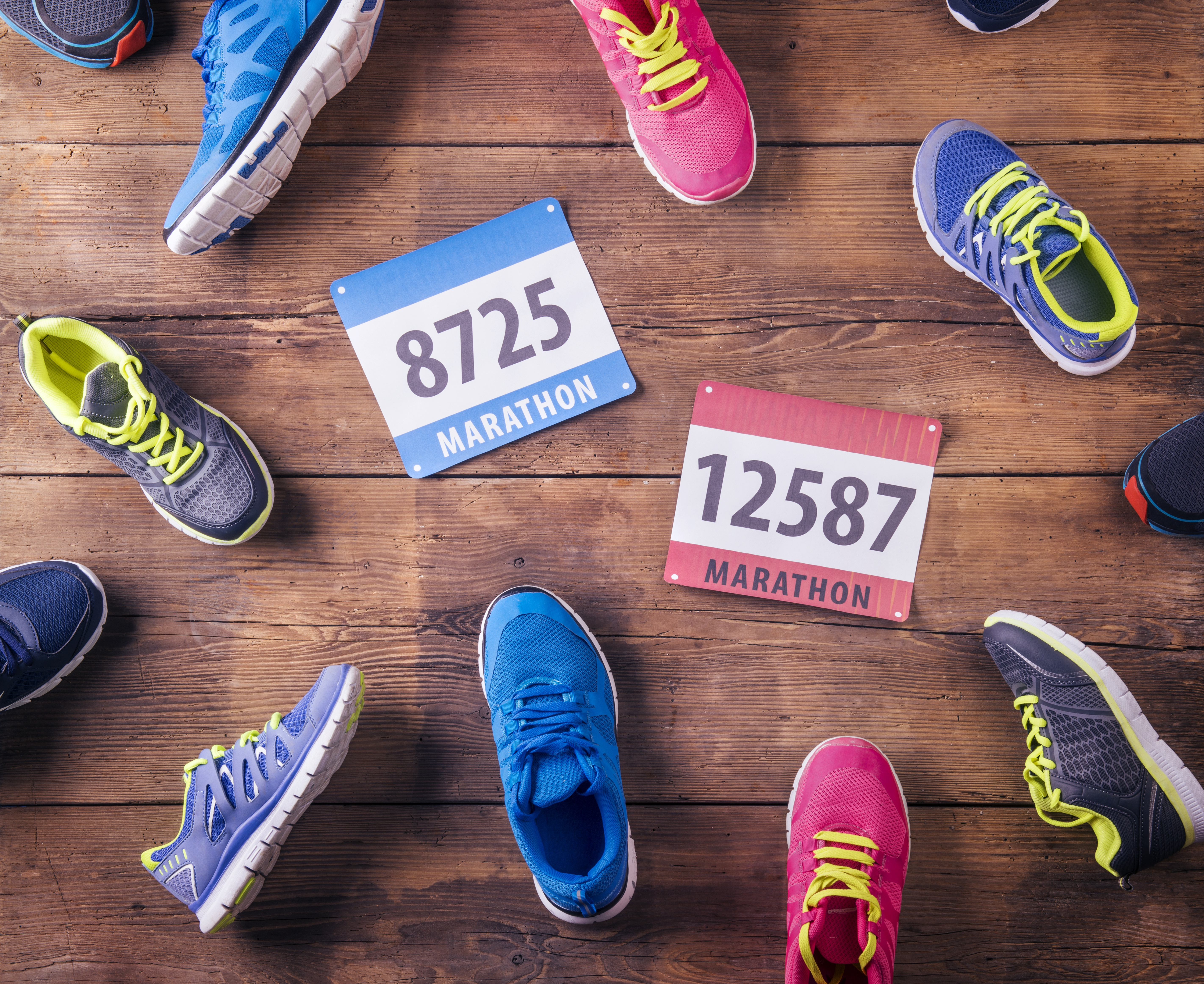 graphicstock-various-running-shoes-and-race-numbers-laid-on-a-wooden-floor-background_SRxlqc_aZZ.jpg