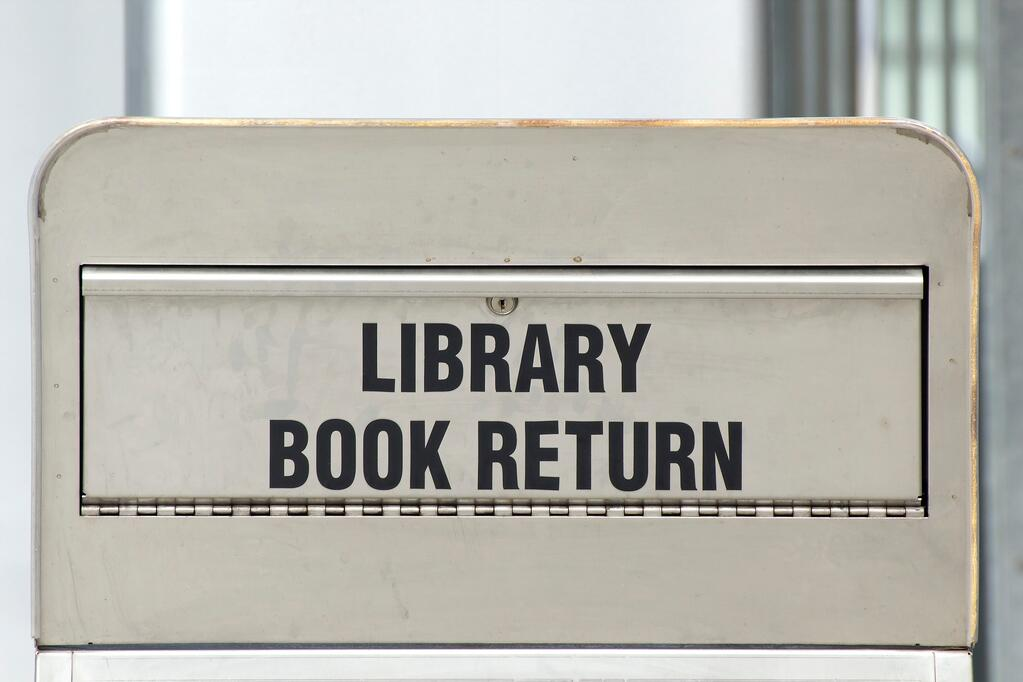 library-book-return-in-article-about-Laura-Bush-library-grants