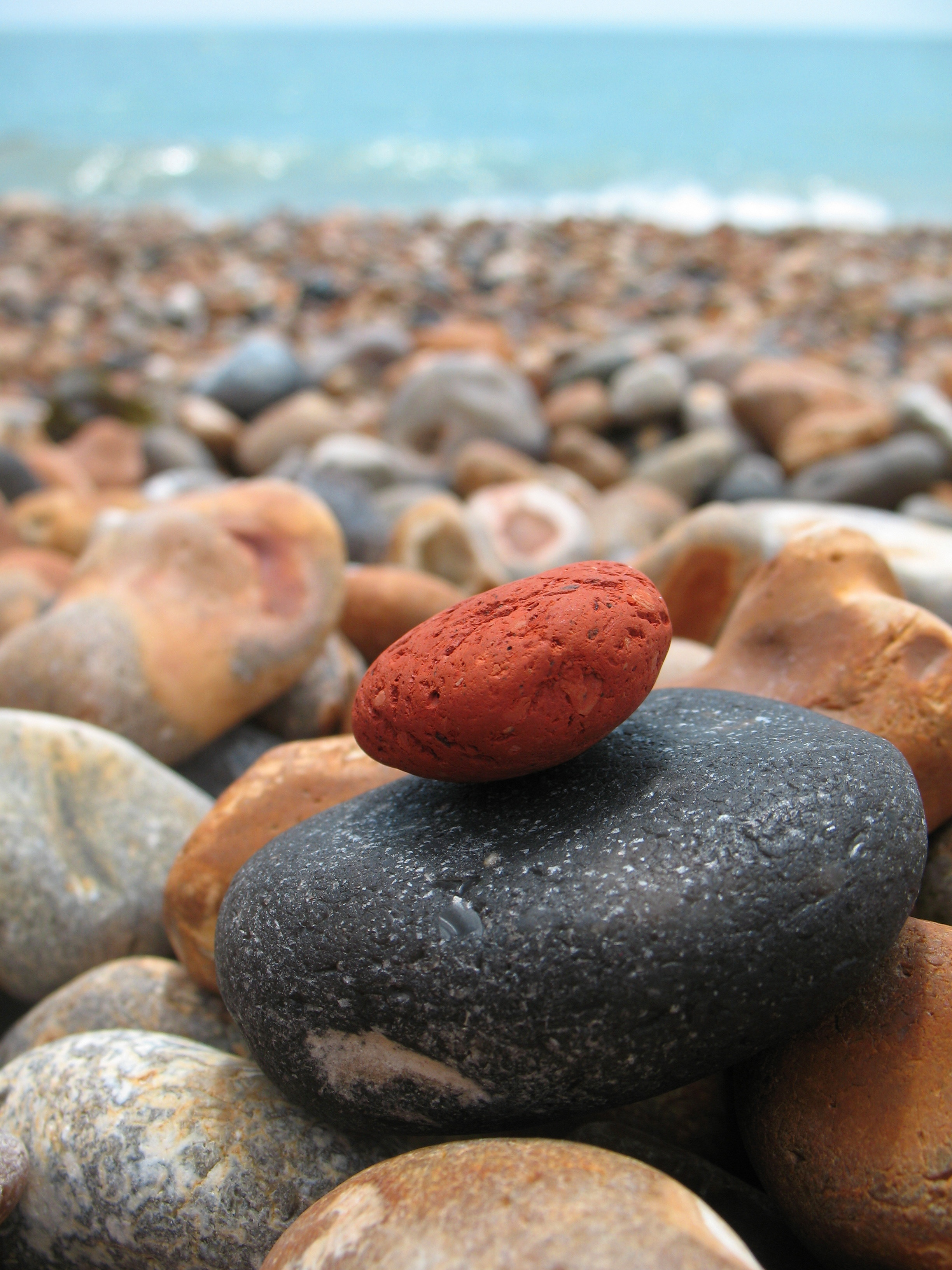 Rocks at Shoreline in an Article About Stopping Gang and Youth Violence and the Safe and Thriving Communities Program