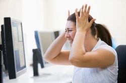 woman-in-computer-room-in-an-article-about-grant-applications-and-errors-to-avoid+