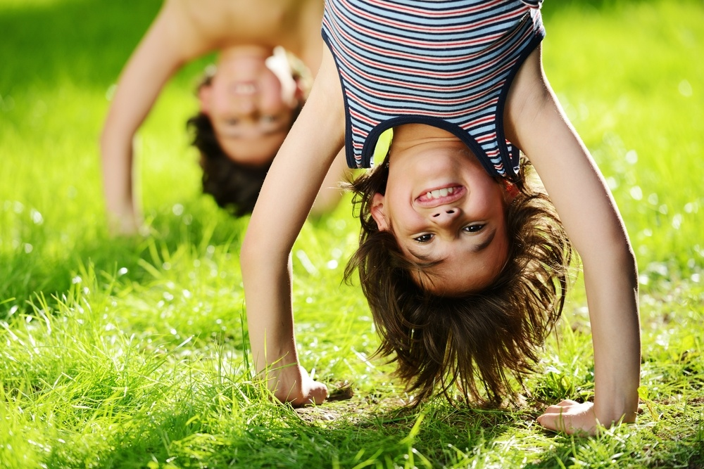 kids-playing-upside-down-in-a-post-about-10-minute-walk-program-grant
