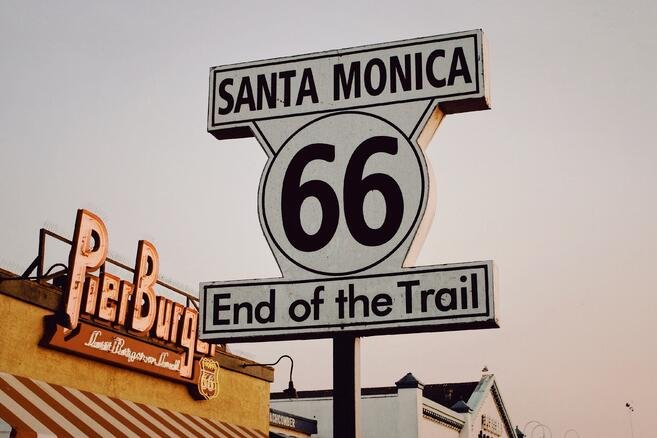 route-66-sign-in-post-about-historic-preservation-grants