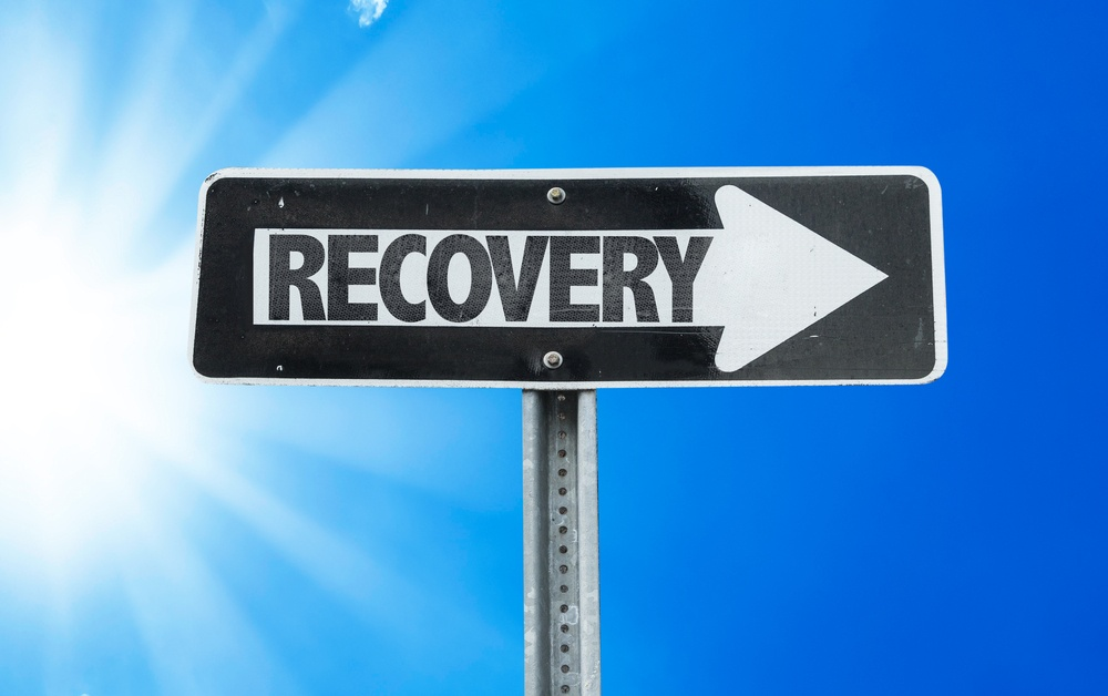 Recovery direction sign with a beautiful day.jpeg